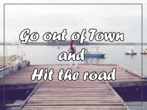 go out of town and hit the road